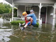The Texas National Guard rescuing a Houston resident during Hurricane Harvey.