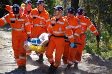SES volunteers performing a rescue in bushland. Photo by ACT SES.