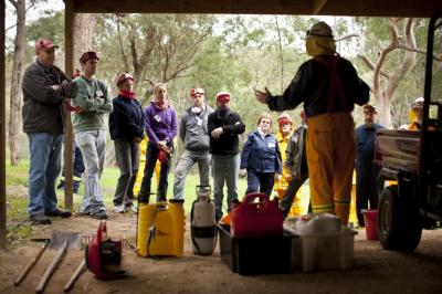 Brigade personnel instruct residents how to prepare for a bushfire. Photo: Damien Ford, NSW Rural Fire Service