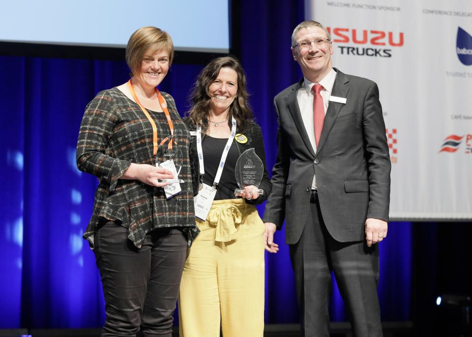 Dr Blythe McLennan from RMIT University and Amanda Lamont from the Australian Institute for Disaster Resilience receiving an award from Bushfire and Natural Hazards CRC CEO Dr Richard Thornton.