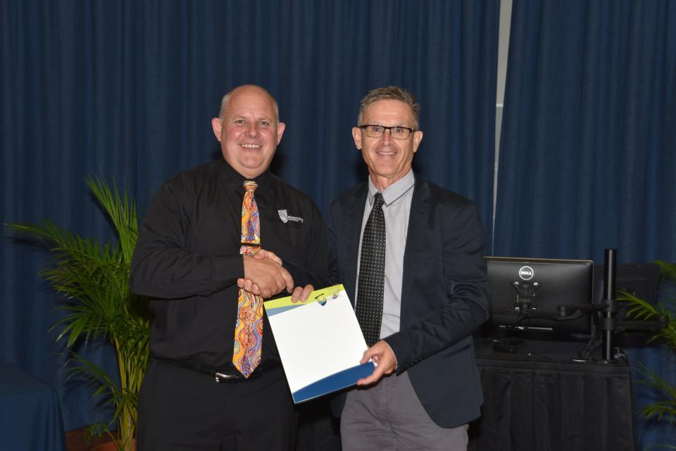 CRC researcher, Prof Kevin Ronan recieving his award from CQUniveristy