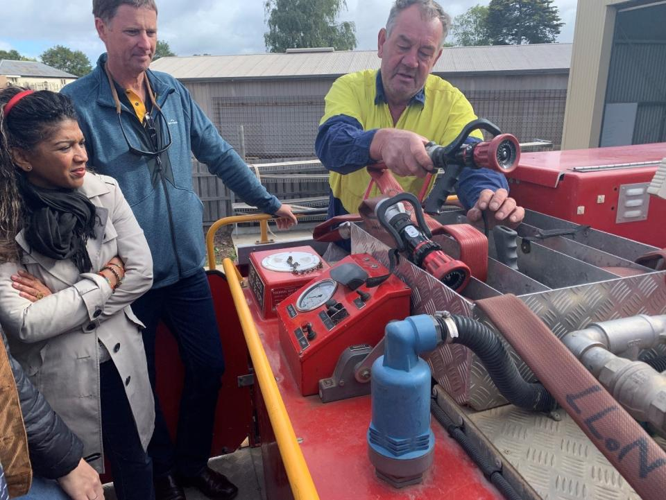 Lancefield CFA asset manager Henry explaining equipment to Matthew Hayne and Desiree Beekharry