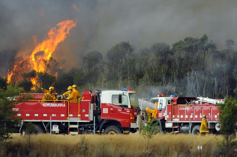 Black Saturday firefighters battling flames in Victoria. When we laud fire fighters as heroes, we fail to acknowledge the ongoing impact of the fires. Photo: Andrew Brownbill