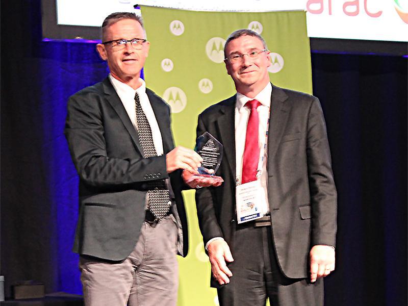 Kevin Ronan receives award from Richard Thornton