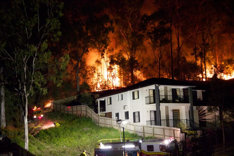 A bushfire rages behind a Brisbane home. Photo: HighExposure (CC BY-NC-ND-2.0)