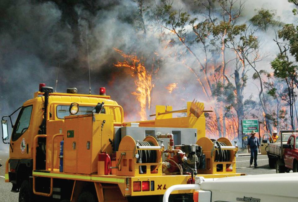 Fire suppression activities by Queensland RFS crews. Photo credit: Qld RFS.