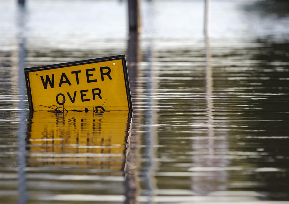 A 'water over road' sign at Rockhampton, Queensland. Photo: Rex Boggs