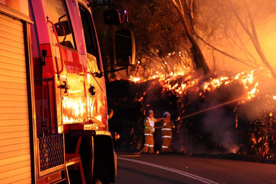 Volunteer firefighters battle a blaze. Photo: Ben Shepard NSW RFS