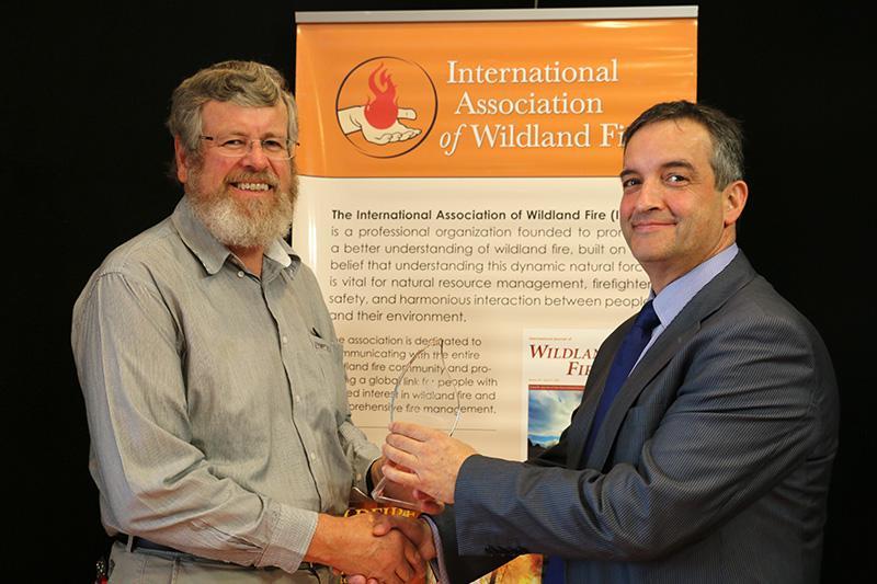 Dr Kevin Tolhurst (left) receives the Ember Award from IAWF Vice-President Alen Slijepcevic.