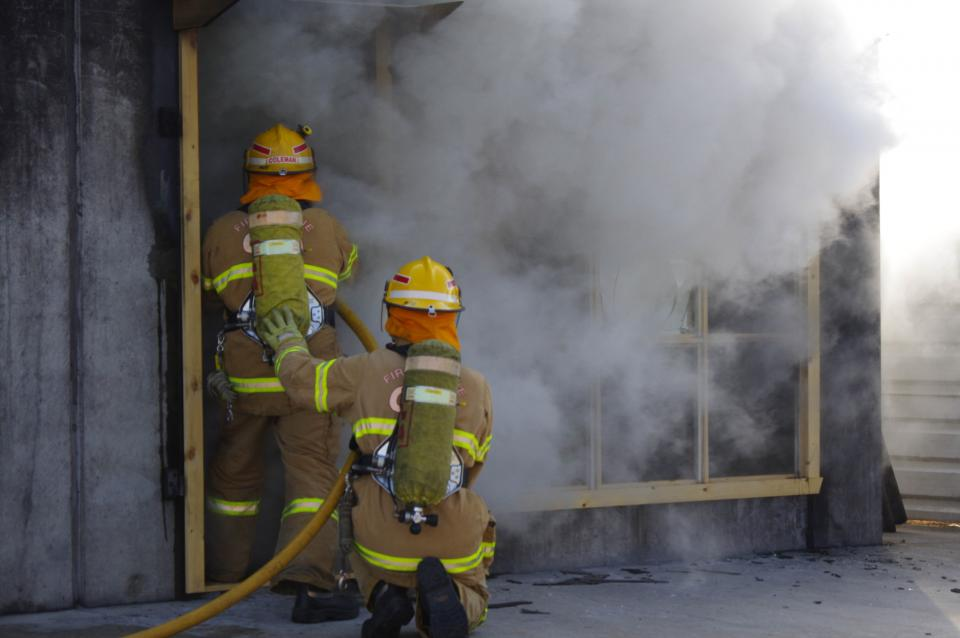 Firefighters training for a structure fire.
