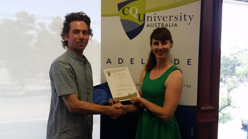 CRC researcher, Dr Kirrilly Thompson receiving her award from CQUniveristy