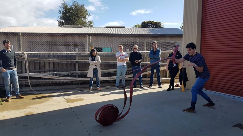 Communications assistant Gabriel Zito performing a 'hose-bowl'