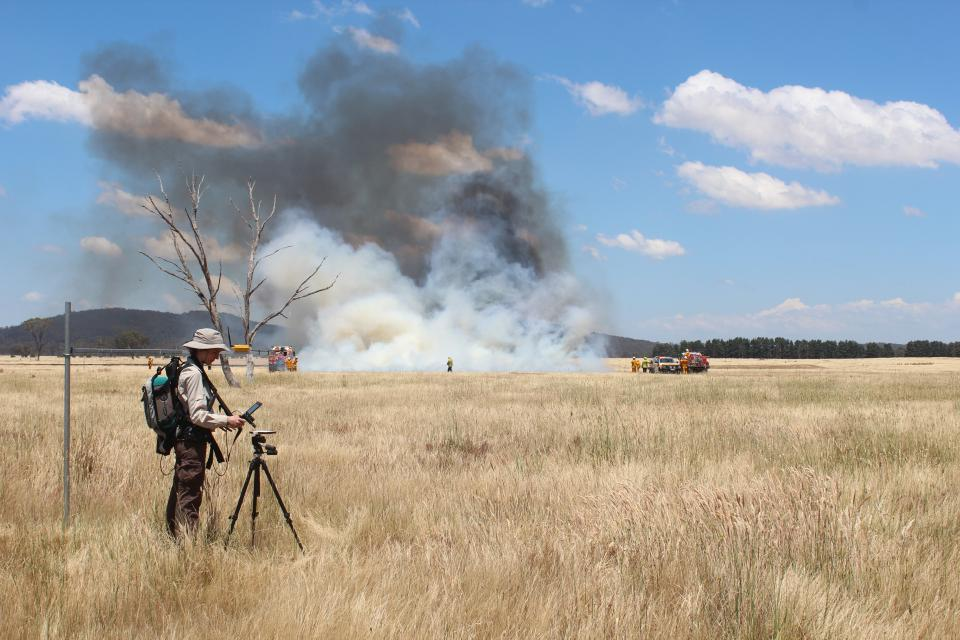 Dr Marta Yebra in the field conducting a grass fire experiment. Photo: Carolina Luiz.