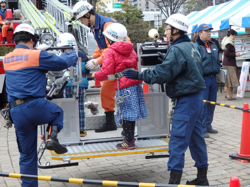 In addition to the main conference, many exhibitions took place. Here local firefighters show children how their cherry-picker operates. Photo by Tony Jarrett.