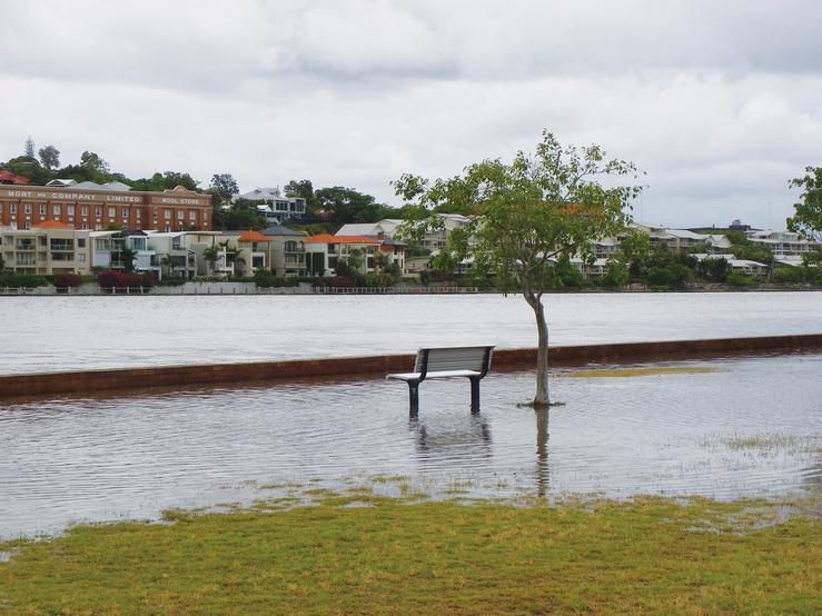 A bench at a park submerged from rising water levels. Photo: Liese Coulter