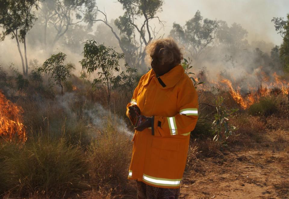 Joy Seccin making a firebreak on the Ganalanga Mindibirrina IPA. Photo: van Wezel , May 2017.