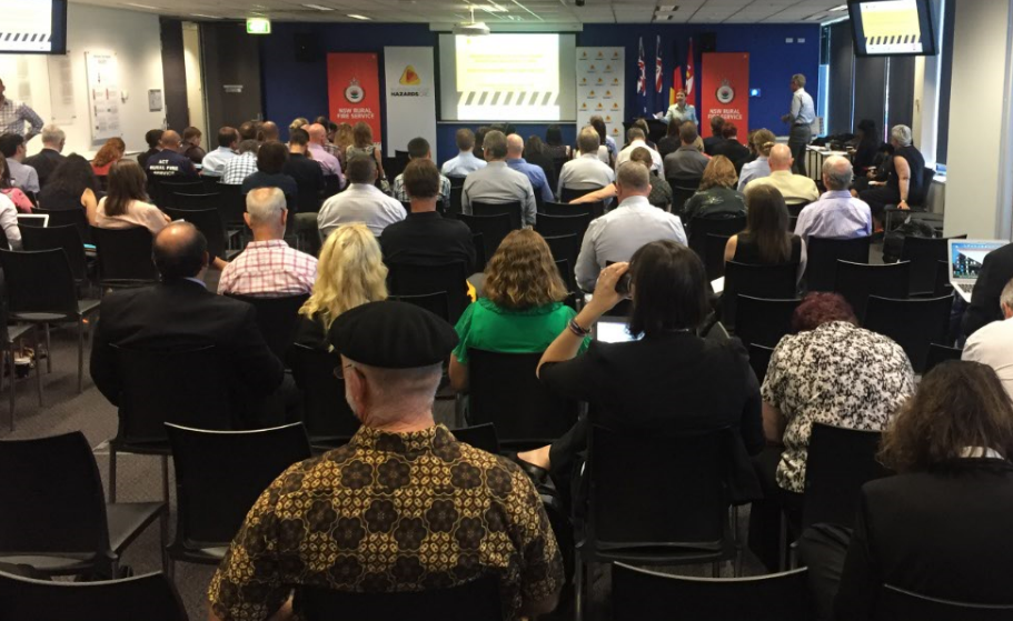 Attendees listening to a presentation at the Sydney RAF.