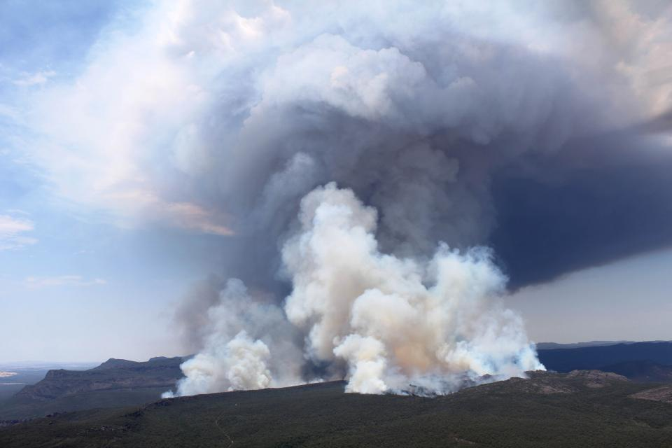 A large smoke plume from the 2014 Grampians bushfire. Photo: Wayne Rigg, CFA