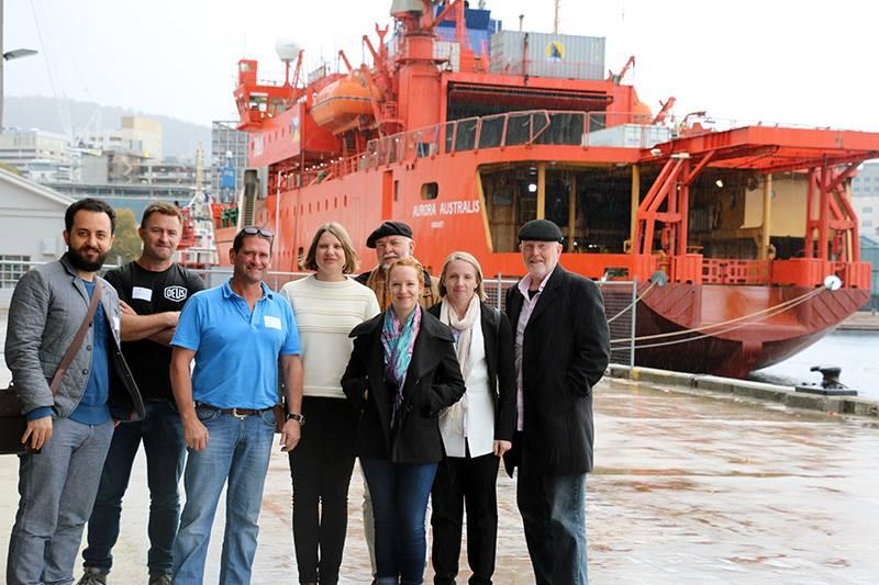 PhD students with the Aurora Australis in Hobart.