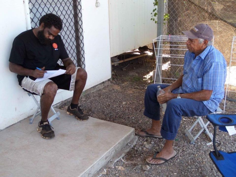Kingswood Dirdi, ARPNet member, surveying Otto Dann, Gunbalanya resident, about perceptions of natural hazard risk.