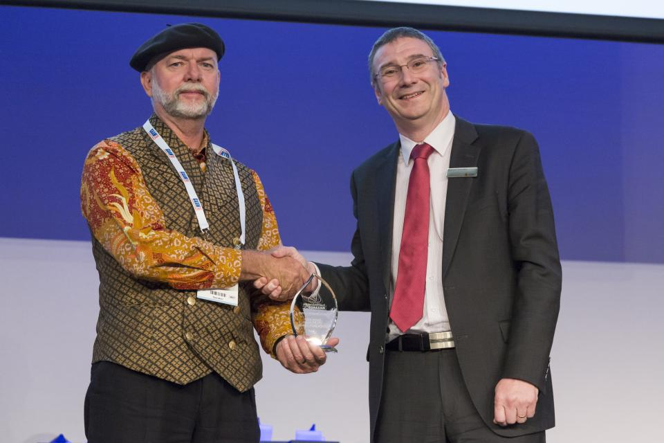 Steve Sutton receives his Special Recognition award from Dr Richard Thornton.