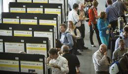 Delegates looking at CRC research posters.