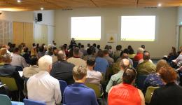 Attendees listening to a presentation at the Forum.