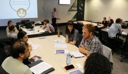 CRC students discussing how to best communicate their research.