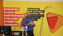 Dr David Henderson explaining his research on cyclone mitigation.